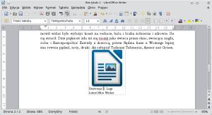 Okno LibreOffice Writer. Przykładowy dokument zwstawioną grafiką. Podnią znajduje się podpis.