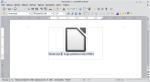 Okno programu Writer. Ramka tekstowa zawiera grafikę i akapit z podpisem. Akapit ten jest zaznaczony.