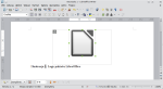 Okno programu Writer. Ramka tekstowa zawiera grafikę. Akapit z podpisem znajduje się poniżej. Grafika jest zaznaczona.
